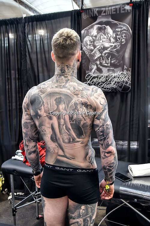 Jiri Zmetek Vintr, Tattoo a client at The Great British Tattoo Show, on 26 May 2019, London, UK.