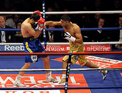 Amir Khan connects with a right cross during the WBA Light Welterweight title fight between Amir Khan (Challenger) and Andreas Kotelnik (Champion) at the MEN Arena on July 18, 2009 in Manchester, England.