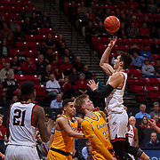 31 January 2017:  The San Diego State Aztecs men's basketball team hosts Wyoming Tuesday night at Viejas Arena. San Diego State forward Matt Hotel (10) attempts a jump shot in the key while being defended by Wyoming forward Haden Dalton (20) in the second half. Hotel was called for a charge and the basket was called off. The Aztecs beat the Cowboys 77-68 at half time. www.sdsuaztecphotos.com