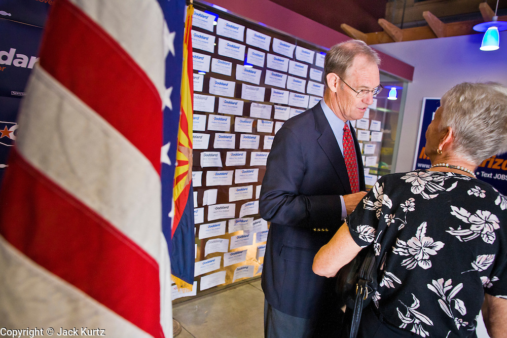 08 OCTOBER 2010 - PHOENIX, AZ:  Terry Goddard (CQ) speaks to asupporter at his campaign headquarters in downtown Phoenix Friday, Oct. 8 before a press conference. Goddard lost the election to sitting Governor Jan Brewer, a conservative Republican.     PHOTO BY JACK KURTZ