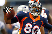 ARLINGTON, TX - OCTOBER 6:  Julius Thomas #80 of the Denver Broncos yells after running the ball for a touchdown against the Dallas Cowboys at  AT&T Stadium on October 6, 2013 in Arlington, Texas.  (Photo by Wesley Hitt/Getty Images) *** Local Caption *** Julius Thomas