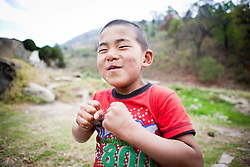 Portrait of a funny boy in Zangkhar village, Bhutan, Asia