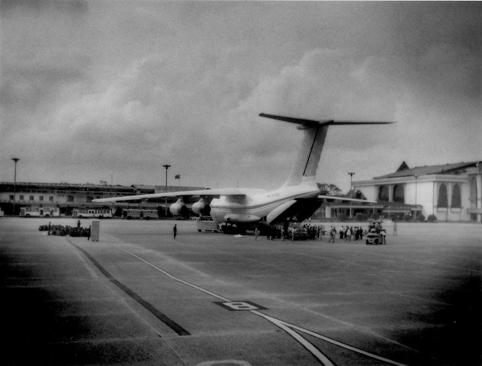 A plane from Russia is the only plane on 9 May in Yangon International Airport bringing relief supplies that Burmese soldiers sit on the tarmac (left) and wait to help out, Burma (Myanmar).  International relief workers have been denied entry visa to the country.