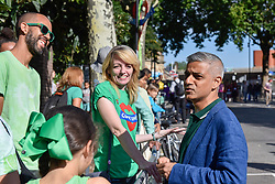 © Licensed to London News Pictures. 27/08/2017. London, UK. Sadiq Khan, Mayor of London, meets members of the public, dressed in Green for Grenfell, during Family Day at the Notting Hill Carnival.  Over one million revellers are expected to attend Europe's biggest street party which takes place over the Bank Holiday Weekend. Photo credit : Stephen Chung/LNP