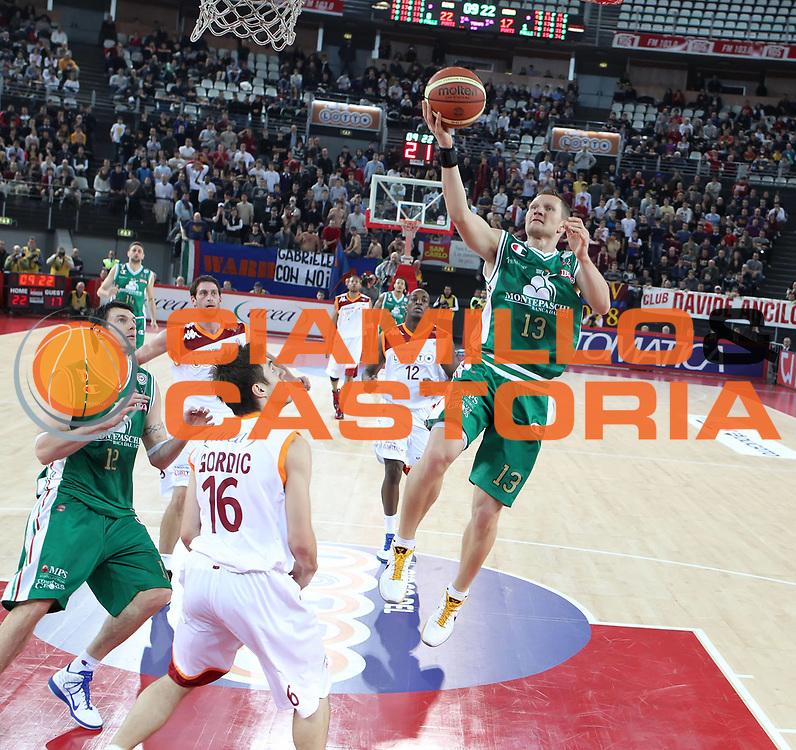 DESCRIZIONE : Roma Lega A 2010-11 Lottomatica Virtus Roma Montepaschi Siena<br /> GIOCATORE : Rimantas Kaukenas<br /> SQUADRA : Montepaschi Siena<br /> EVENTO : Campionato Lega A 2010-2011 <br /> GARA : Lottomatica Virtus Roma Montepaschi Siena<br /> DATA : 16/01/2011<br /> CATEGORIA : tiro<br /> SPORT : Pallacanestro <br /> AUTORE : Agenzia Ciamillo-Castoria/ElioCastoria<br /> Galleria : Lega Basket A 2010-2011 <br /> Fotonotizia : Roma Lega A 2010-11 Lottomatica Virtus Roma Montepaschi Siena<br /> Predefinita :