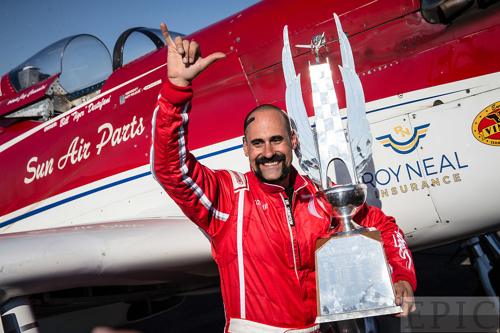 RENO, NV - SEPTEMBER 17: Jay Consalvi poses with the trophy for winning the unlimited gold class championships at the Reno Championship Air Races on September 17, 2017 in Reno, Nevada. (Photo by Jonathan Devich/Getty Images) *** Local Caption *** Jay Consalvi