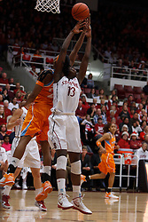 Dec 20, 2011; Stanford CA, USA;  Stanford Cardinal forward Chiney Ogwumike (13) grabs a rebound from Tennessee Lady Volunteers forward Glory Johnson (back) during the first half at Maples Pavilion.  Mandatory Credit: Jason O. Watson-US PRESSWIRE