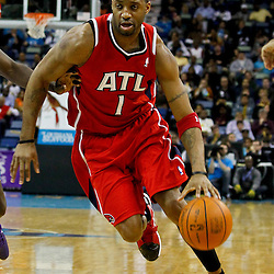 January 29, 2012; New Orleans, LA, USA; Atlanta Hawks small forward Tracy McGrady (1) against the New Orleans Hornets during a game at the New Orleans Arena. The Hawks defeated the Hornets 94-72.  Mandatory Credit: Derick E. Hingle-US PRESSWIRE