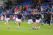 Leicester City midfielder Riyad Mahrez (26) in the warm up with Leicester players during the Barclays Premier League match between Crystal Palace and Leicester City at Selhurst Park, London, England on 19 March 2016. Photo by Phil Duncan.