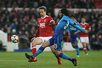 Nottingham Forest's Kieron Dowell looks to close down Arsenal's Mohammed Elneny  during The Emirates FA Cup Third Round match between Nottingham Forest and Arsenal at City Ground on January 7, 2018 in Nottingham, England..