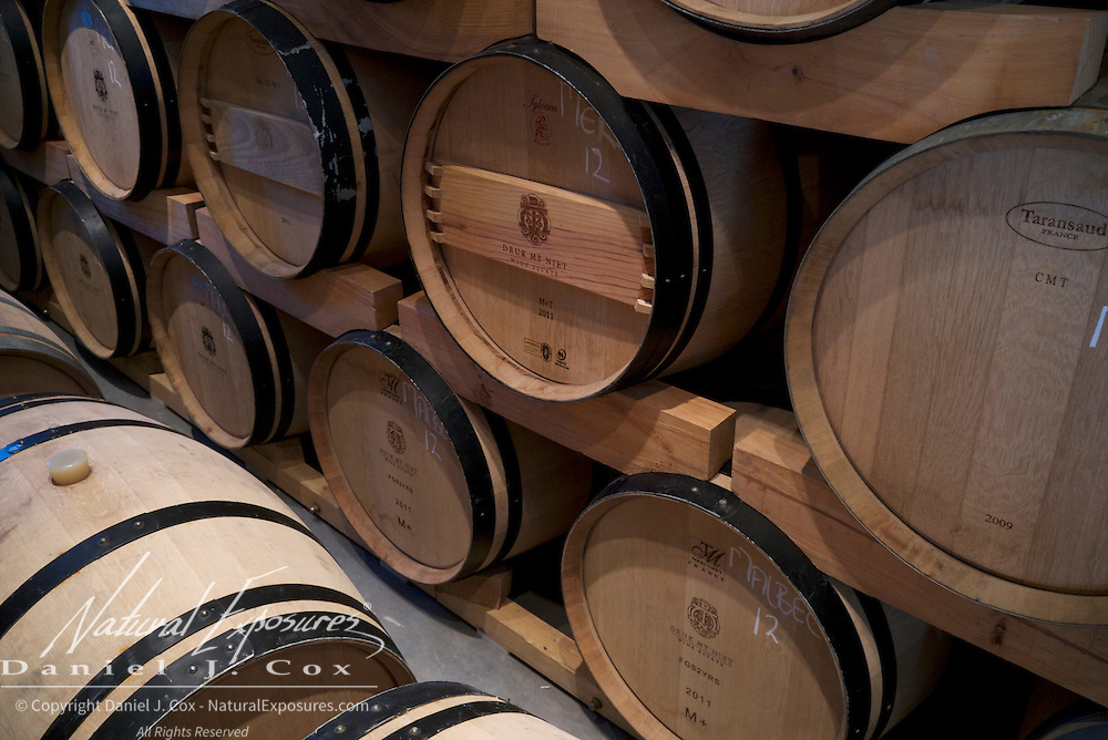 Oak barrels hold the recent harvest of wine from the Druk My Niet vneyards, South Africa.