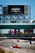 """Huge posters advertising the HBO series """"Boardwalk Empire"""" dominate the boardwalk  in Atlantic City in this image from October 2010. The city is in trouble after three casinos have closed in rapid succession, the latest being The Revel Resort."""
