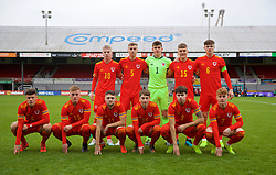 NEWPORT, WALES - Wednesday, November 13, 2019: Wales players line-up for a team group photograph before the UEFA Under-19 Championship Qualifying Group 5 match between Wales and Poland at Rodney Parade. Back row L-R: Keenan Pattern, Ryan Astley, goalkeeper Lewis Webb, Cameron Evans, captain Morgan Boyes. Front row L-R: Sam Bowen, Isaac Davies, Joseph Adams, Iestyn Hughes, Neco Williams, Samuel Pearson. (Pic by David Rawcliffe/Propaganda)
