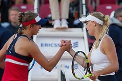 Elise Mertens (Belgium) and Caroline Wozniacki (Denmark, right) at the 2017 WTA Ericsson Open in Båstad, Sweden, July 29, 2017. Photo Credit: Katja Boll/EVENTMEDIA.