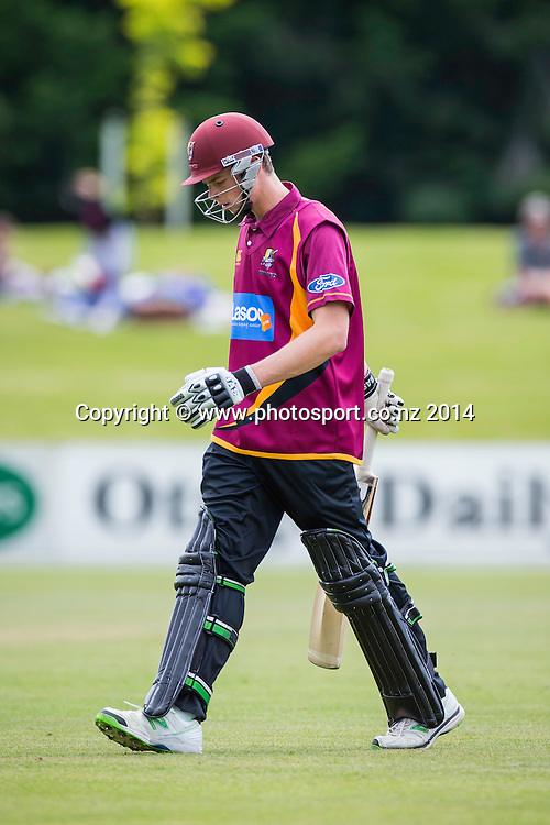 Mitchell Santner leaves the field after being bowled by Jacob Duffy of the Otago Volts - Volts v Knights, Saturday, 27 December 2014, Molyneux Park, Alexandra - List-A Match - Ford Trophy CREDIT: Libby Law / www.photosport.co.nz