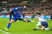 Tottenham Hotspur defender Jan Vertonghen (5) performs a sliding tackle on Chelsea midfielder Eden Hazard (10) during the EFL Cup Semi-Final match between Tottenham Hotspur and Chelsea at Wembley Stadium, London, England on 8 January 2019.