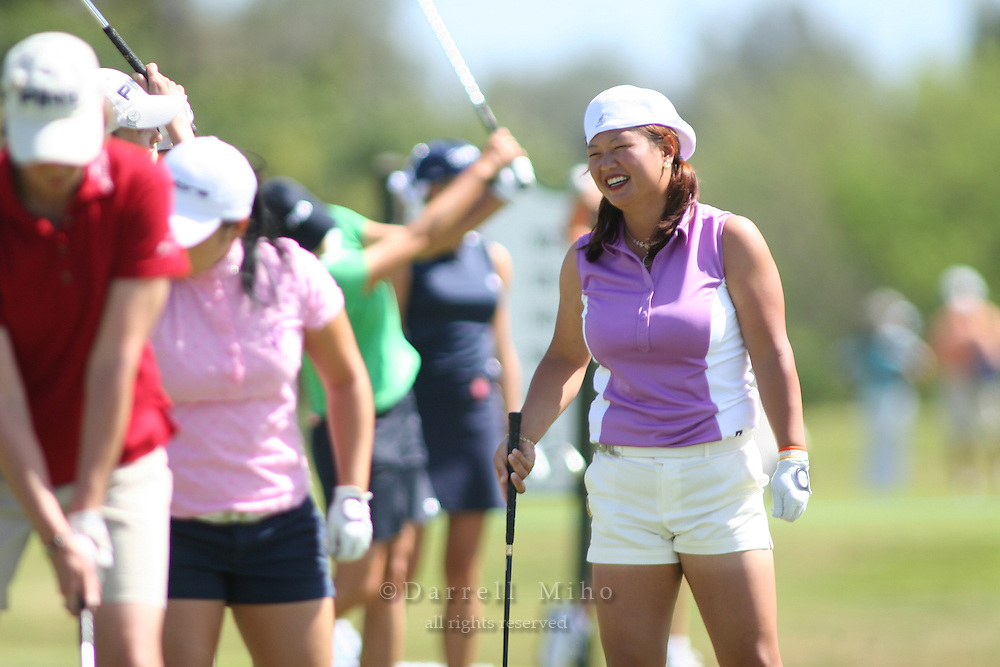 February 16, 2006 - Kahuku, HI - Chritina Kim (right) practices on the driving range with other LPGA players before Round 1 of the LPGA SBS Open at Turtle Bay Resort...Photo: Darrell Miho