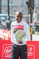 Enrique Da Costa of Brazil from the men's T44-46 IPC race with his salver at the Virgin Money London Marathon 2014 at the finish line on Sunday 13 April 2014<br /> Photo: Dillon Bryden/Virgin Money London Marathon<br /> media@london-marathon.co.uk