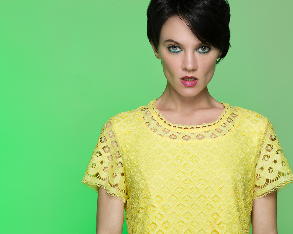 Houston fashion model Sarah Kate Harrison posing in yellow dress.