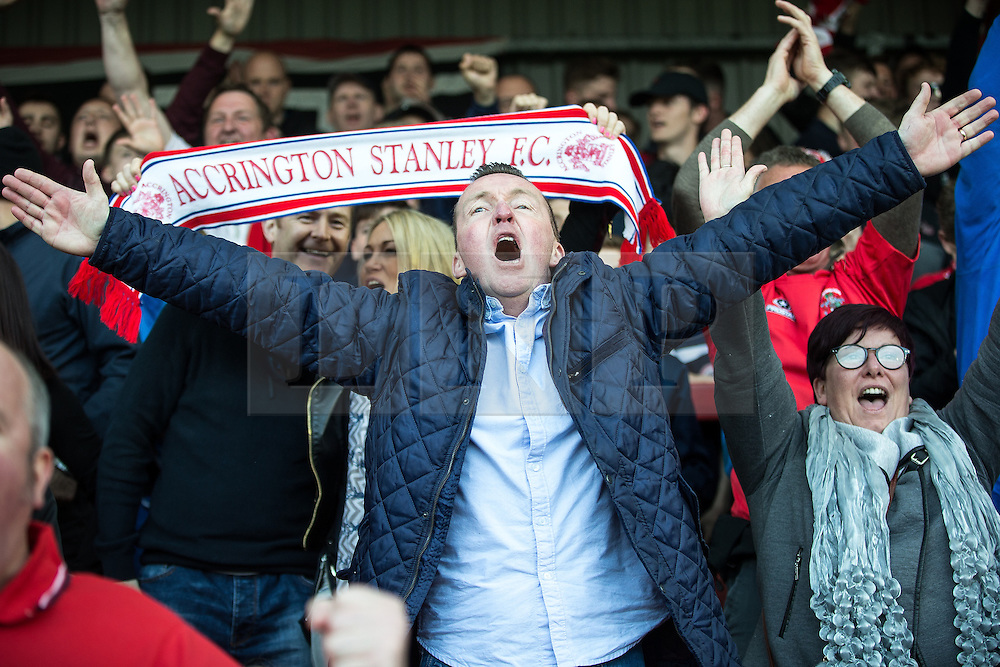 © Licensed to London News Pictures . 18/05/2016 . Accrington , UK . Accrington Stanley fans cheer as their team goes a goal ahead from a penalty . Accrington Stanley take on AFC Wimbledon at the Wham Stadium , in the 2nd leg of their League Two tie , the result from which will decide which team goes on to the final at Wimbledon . Photo credit : Joel Goodman/LNP