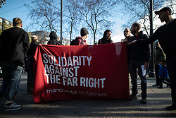 © Licensed to London News Pictures . 20/10/2018 . Manchester , UK . Antifascist counter protesters in Piccadilly Gardens . Street protest movement , the English Defence League ( EDL ) , hold a demonstration , opposed by anti-fascists , including Unite Against Fascism ( UAF ) , in Manchester City Centre . Amongst the reasons for their protest , the EDL cite news reports that revealed an imam at the Didsbury Mosque where Manchester Arena bomber Salman Abedi prayed , praised armed jihad in a sermon delivered just days before Abedi bought a ticket for the Ariana Grande concert at which he killed twenty two people . Photo credit : Joel Goodman/LNP