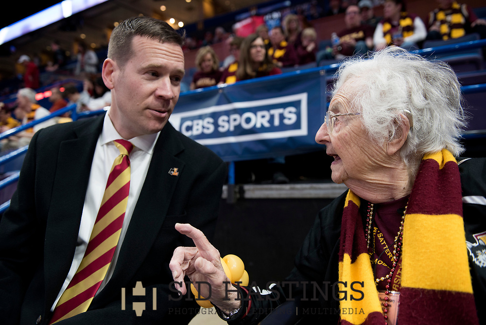 Loyola University Chicago Athletics Director Steve Watson talks with Sister Jean Dolores Schmidt, BVM, before the Ramblers' battle Illinois State University during the championship game of the Missouri Valley Conference men's basketball tournament at Scottrade Center in St. Louis Sunday, March 4, 2018. Photo © copyright 2018 Sid Hastings.