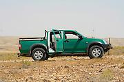 green pickup truck, in sede boker desert, israel