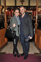KARA TOINTON and ARTEM CHIGVINTSEV at the opening night of Totem by Cirque du Soleil held at The Royal Albert Hall, London on 5th January 2011.