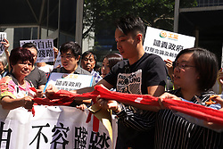 October 6, 2018 - Hong Kong, CHINA - In light of HKSARs refusal to renew working visa for British journalist, Asia editor of FINANCIAL TIMES, present vice president of Hong Kong FCC, Victor Mallet, Hong Kong citizens staged a protest this morning outside Immigration Department Building tearing off a red cordon in a symbolic gesture expressing that the baseline of Hong Kong's freedom of press has been bleached and trampled on, by the Hong Kong government. Oct-6,2018 Hong Kong.ZUMA/Liau Chung-ren (Credit Image: © Liau Chung-ren/ZUMA Wire)