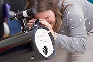 New Paltz, New York - A woman watches the Transit of Venus through a filtered telescope on the State University of New Paltz campus on June 5, 2012. Venus crossed in front of the sun and was visible as a small black disk. The next Venus transit will not occur until 2117.
