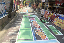 October 8, 2018 - Kolkata, West Bengal, India - Artist create street graffiti dedicates to the rights of sex workers in a community Durga Puja pandal or temporary platfrom. The annual five days festival begins on October 15 and worship Goddess Durga who symbolized power and the triumph of good over evil in Hindu mythology. (Credit Image: © Saikat Paul/Pacific Press via ZUMA Wire)