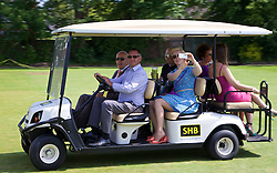 LIVERPOOL, ENGLAND - Sunday, June 22, 2014: Spectators are ferried to the court in a golf buggy during Day Four of the Liverpool Hope University International Tennis Tournament at Liverpool Cricket Club. (Pic by David Rawcliffe/Propaganda)