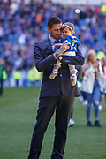 Kyle Lafferty of Rangers FC comes out to thank thank the fans holding his daughter following the Ladbrokes Scottish Premiership match between Rangers and Celtic at Ibrox, Glasgow, Scotland on 12 May 2019.