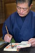 Pilgrimsboken signeras vid tempel nummer 76, Konzō-ji. <br /> <br /> Pilgrimsvandring till 88 tempel på japanska ön Shikoku till minne av den japanske munken Kūkai (Kōbō Daishi). <br /> <br /> Fotograf: Christina Sjögren<br /> Copyright 2018, All Rights Reserved<br /> <br /> <br /> The Konzō-ji (金倉寺) temple. Temple number 76 at the Shikoku Pilgrimage, 88 temples associated with the Buddhist monk Kūkai (Kōbō Daishi) on the island of Shikoku, Naruto,Tokushima Prefecture, Japan
