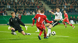 MONCHENGLADBACH, GERMANY - Wednesday, October 15, 2008: Wales' captain Craig Bellamy in action against Germany's goalkeeper Rene Adler during the 2010 FIFA World Cup South Africa Qualifying Group 4 match at the Borussia-Park Stadium. (Photo by David Rawcliffe/Propaganda)