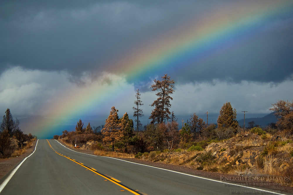 Rainbow over rural country road in the Hat Creek Valley, Shasta County, California