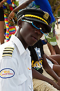 "Young man ""captain"" that manage the boats that take people from Mussulo island to Luanda, the ""glasses"" are made of electric cable"