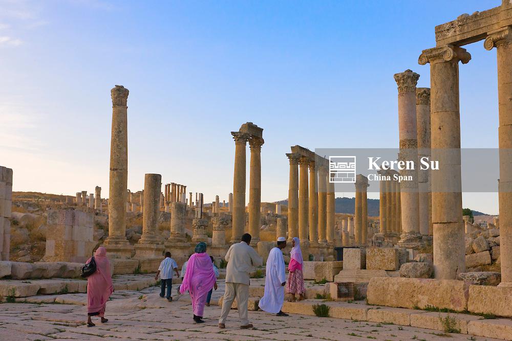 Tourists in column street, ancient Jerash ruins, Amman, Jordan