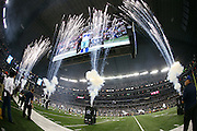 Fireworks shoot in the air while Dallas Cowboys defensive end DeMarcus Ware (94) is shown on the jumbotron during Dallas Cowboys player introductions before the NFL week 6 football game against the Washington Redskins on Sunday, Oct. 13, 2013 in Arlington, Texas. The Cowboys won the game 31-16. ©Paul Anthony Spinelli