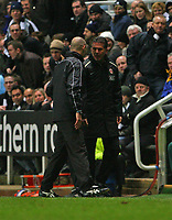 Photo: Andrew Unwin.<br /> Newcastle United v Manchester United. The Barclays Premiership. 01/01/2007.<br /> Manchester United's Carlos Querez (R) argues with the fourth official, Howard Webb (L).