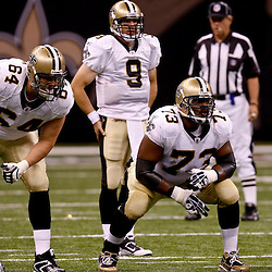 August 21, 2010; New Orleans, LA, USA; New Orleans Saints offensive tackle Zach Strief (64) and guard Jahri Evans (73) line up for a play during the first quarter of a preseason game against the Houston Texans at the Louisiana Superdome. Mandatory Credit: Derick E. Hingle