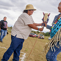 Anita Williams gets the handoff from Danielle Dawes in a hobby horse relay during the Rock Springs Community Event at the Rock Springs Chapter House July 28.