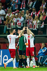 11.10.2014, National Stadium, Warsaw, POL, UEFA Euro Qualifikation, Polen vs Deutschland, Gruppe D, im Bild Arkadiusz Milik poland #7 Sebastian Mila poland #18 zmiana // Arkadiusz Milik poland #7 Sebastian Mila poland #18 substitution // during the UEFA EURO 2016 Qualifier group D match between Poland and Germany at the National Stadium in Warsaw, Poland on 2014/10/11. EXPA Pictures © 2014, PhotoCredit: EXPA/ Newspix/ Sebastian Borowski<br /> <br /> *****ATTENTION - for AUT, SLO, CRO, SRB, BIH, MAZ, TUR, SUI, SWE only*****
