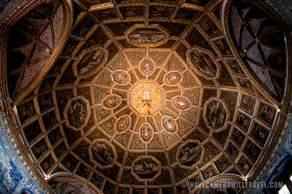 SINTRA, Portugal - This tower is situated on the site of the old Casa da Meca built during the reign of Manuel I (1495-1521). The ceiling in carved gilded woodwork is crowned by the royal coat-of-arms and is surrounded by the armorial bearings of 72 noble families. Late 17th to early 18th century panels of painted tiles depict courtly and hunting scenes. The Palace of Sintra (Palácio Nacional de Sintra) is a mediaeval royal palace in Sintra and part of the UNESCO World Heritage Site that encompasses several sites in and around Sintra, just outside Lisbon. The palace dates to at least the early 15th century and was at its peak during the 15th and 16th centuries. It remains one of the best-preserved royal residences in Portugal.