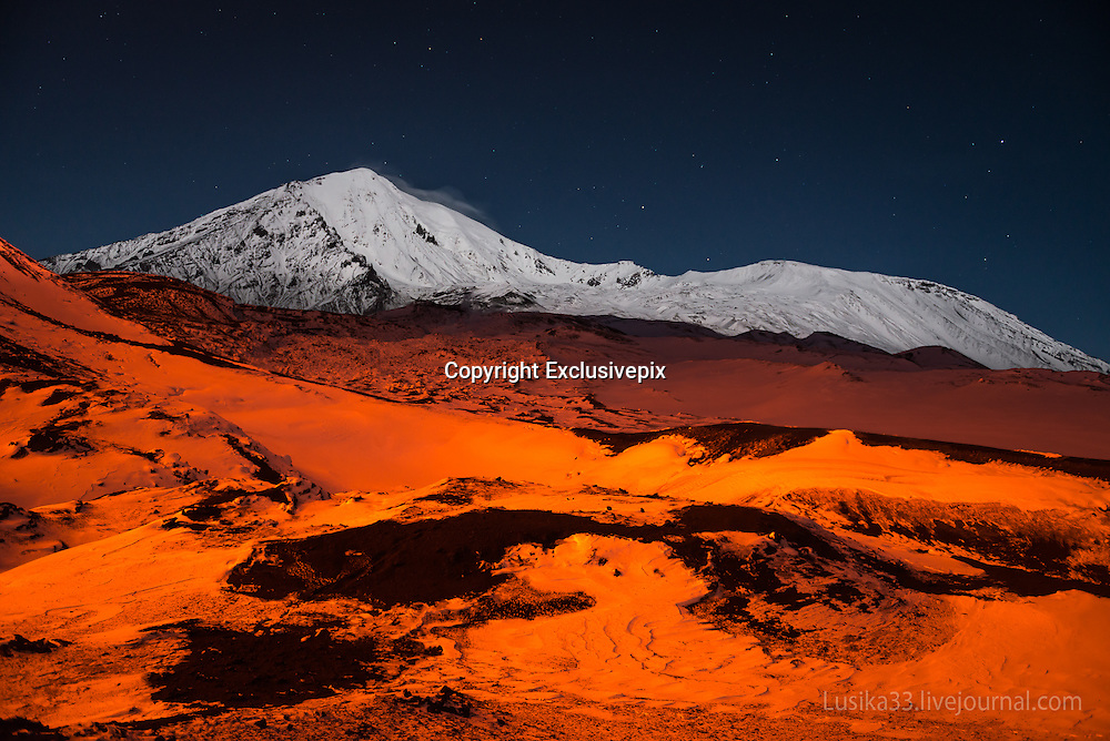 The Magic Night<br /> <br /> What a truly magic night! The sun going behind the horizon and the erupting Tolbachik volcano (Kamchatka) whose lava paths illuminated the night.<br /> &copy;Andrey Lu/Exclusivepix