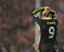 BLACKPOOL, ENGLAND - Wednesday, January 12, 2011: Liverpool's Fernando Torres looks dejected after his side lose 2-1 to Blackpool during the Premiership match at Bloomfield Road. (Photo by David Rawcliffe/Propaganda)