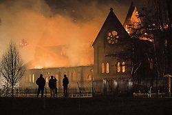 © Licensed to London News Pictures . 13/02/2017. Salford , UK . A large fire guts The Church of the Ascension on Ascension Road in Broughton , Salford , overnight . The blaze , which is visible across the city of Manchester and is in a residential area , started before midnight on Sunday evening . Photo credit: Joel Goodman/LNP