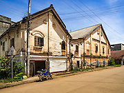 16 JUNE 2016 - PAKSE, CHAMPASAK, LAOS:  Traditional French colonial buildings in Pakse. Most of the buildings in this style have been torn down and replaced with more modern buildings. Pakse is the capital of Champasak province in southern Laos. It sits at the confluence of the Xe Don and Mekong Rivers. It's the gateway city to 4,000 Islands, near the border of Cambodia and the coffee growing highlands of southern Laos.     PHOTO BY JACK KURTZ