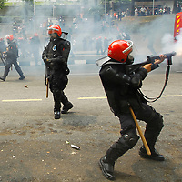 Malaysian riot police fire a teargas to protestor during a crackdown on Bersih rally calling for electoral reforms  in Kuala Lumpur, Malaysia 9 July 2011.<br /> With national elections due by 2013, the opposition backed protest, Bersih is demanding reforms including measures to prevent vote-buying and fraud.