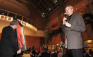 "Artist Simon Bull talks as a 36"" x 36"" Master Edition of his ""Lady in Red"" is displayed to the crowd as it is auctioned at the 2007 Wellness Connection Red Dress Gala, at the Schuster Performing Arts Center in Dayton, Saturday night, May 5th."